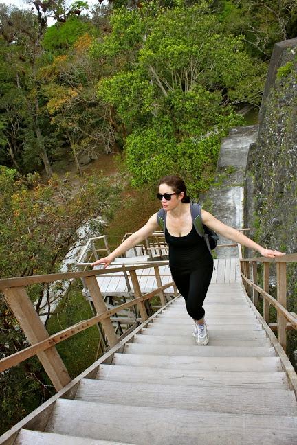 tikal guatemala climb ruins wooden staircase